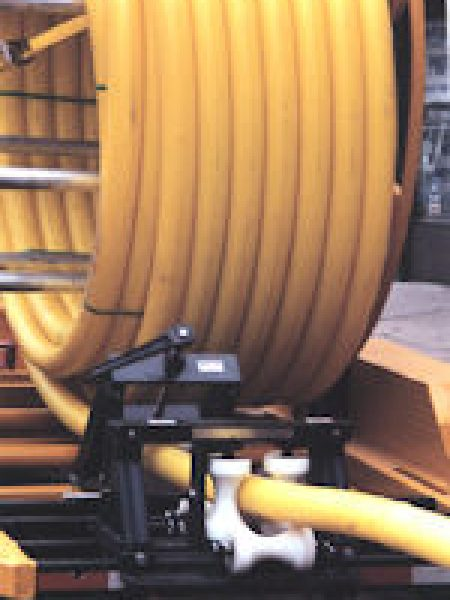 """Corrects the ovality of large diameter coiled PE pipe. The straightening action eliminates the high level of stored energy from the coil, making the pipe much safer to handle and easier to fuse, even at cold temperatures.  Mechanical """"set and forget"""" operation with no gas engine or hydraulic system to maintain. It requires no power source or special operator and virtually zero maintenance."""
